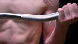 strong caucasian naked male lifting barbell close-up in camera on black Footage