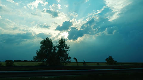 A cloudy sunset over the road ビデオ