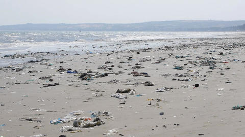 Pan shot of plastic garbage and trash on the beach Footage
