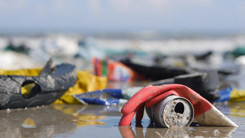 Handheld extreme close up of plastic garbage and trash on beach Footage