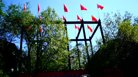 Time lapse shot of the China flags flying in the air Footage