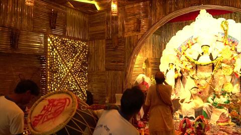 Priest worshipping Goddess Durga, Durga aarti - Hindu ritual Live Action