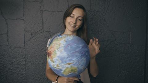 Woman spins the globe 영상물