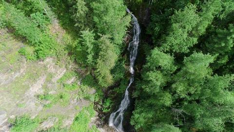 Waterfall in the forest Panoramic aerial view. Summer weather, taiga nature, Footage