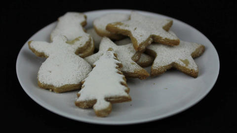 Young hands taking Christmas cookies Stock Video Footage
