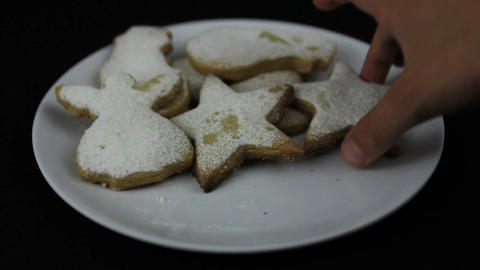Young hands taking Christmas cookies Footage