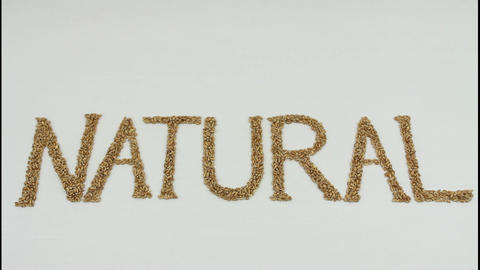 Natural written with wheat kernels Stock Video Footage
