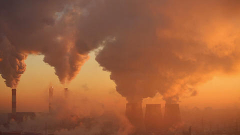 Polluting factory at dawn Stock Video Footage