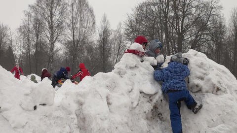 Children play in the snow Stock Video Footage