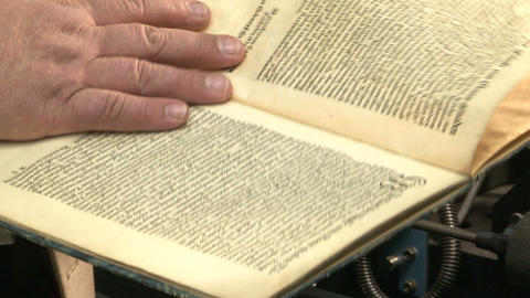 An old book in the hands Stock Video Footage
