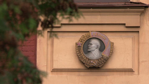 The Order of Lenin on the wall of the building Stock Video Footage