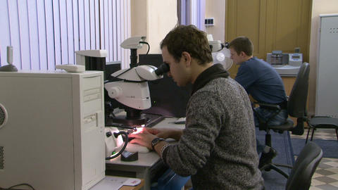 A scientist at the microscope Stock Video Footage