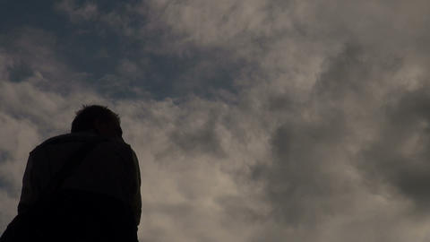 Male silhouette against the sky Stock Video Footage