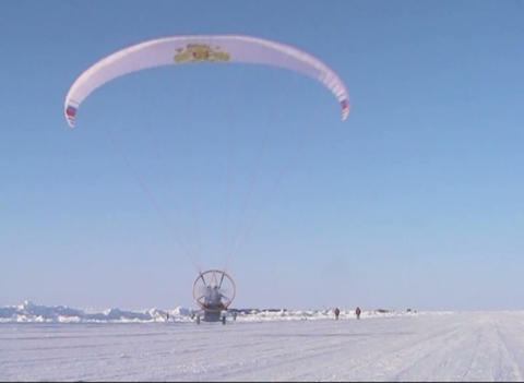 Paraglider with motor and propeller Stock Video Footage