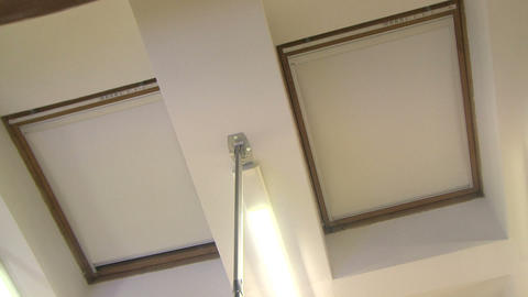 Automatic blinds on the windows in the ceiling Stock Video Footage