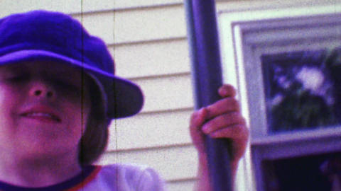 1968: Boy wearing dad's hippie cap style hat with cartoon bear shirt Footage