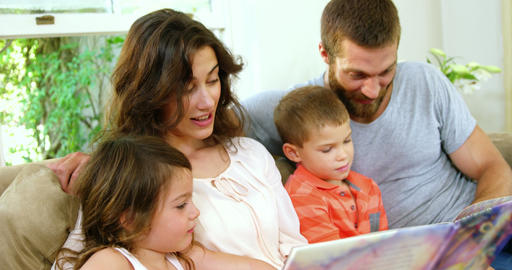 Family reading a children book Live Action