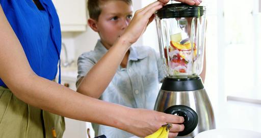 Mon and son preparing juice Footage