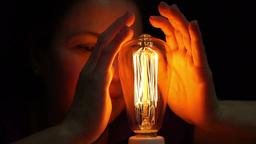 Woman Antique Filament Bulb Warming Hands Footage