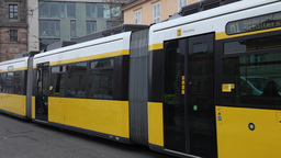 yellow tram passing by in Berlin street, Germany Footage