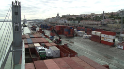 Forklift tractor moving metal shipping containers in harbor Footage