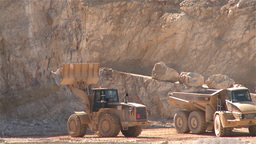 Heavy Building Bulldozer placing stones on a dump truck in a quarry Footage
