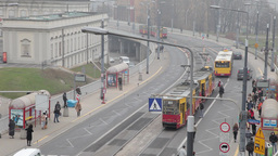 timelapse street with people catching tram and bus in warsaw, Poland Footage