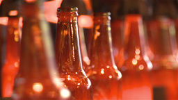 glass beer bottles still hot in manufacturing Footage