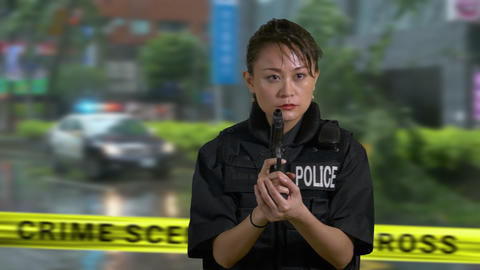 Asian American police officer holds gun looks around… Stock Video Footage