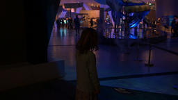 Little Girl Playing with Moving Floor Lights at a Dinosaur Exhibit Footage