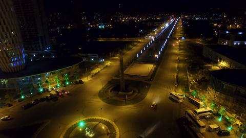 Night view of Heroes Square with boulevard behind in Batumi Georgia, city life Live Action