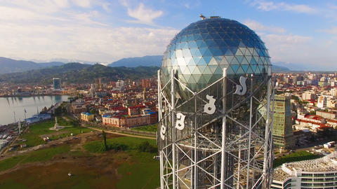 Big silver ball in crown of Alphabetic Tower Batumi Georgia, cultural symbol Live Action