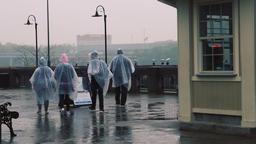 People Walking Under the Rain in Niagara Falls, Ontario Footage