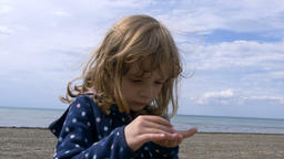 Little Girl on the Shores of Lake Ontario Playing with Pebbles Footage