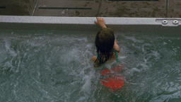 Child Enjoying the Bubbles in a Pool Live Action