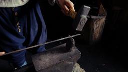 Blacksmith Hammering Metal Piece ビデオ