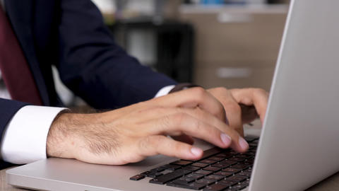 Zoom in dynamic shot close up businessman hands typing fast on laptop keyboard Footage