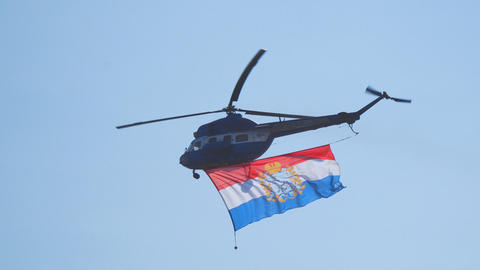 Helicopter flying in the blue sky with the flag of Russia Footage