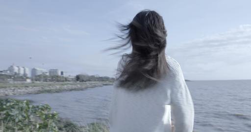 Woman Enjoying Sunrise On Riverside – 4K Stock Video Footage