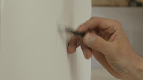 The drawing process: a close-up of the hand pencil and paper GIF