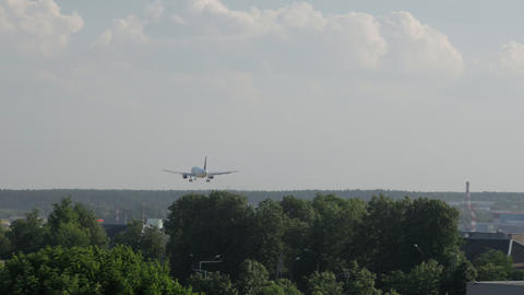 Rear view of boeing airplane landing at the airport Live Action
