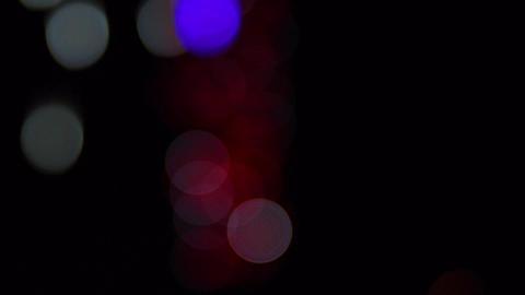 Multi-colored flashing round bokeh Archivo