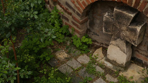 Stone cross standing near church, symbol of unquestioning faith and worship Live Action