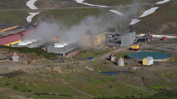 Mutnovskaya Geothermal Power Plant, smoking clouds of steam from pipes Footage