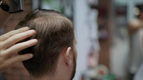 Men dry their hair after a haircut. Men's hair salon Footage