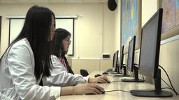 A group of Asian students use computers during training while in the classroom Footage