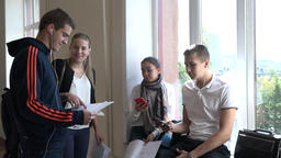 A group of students discuss the project during a break at the university Footage
