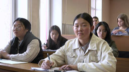 A group of mixed-race students during a lecture in the classroom Footage