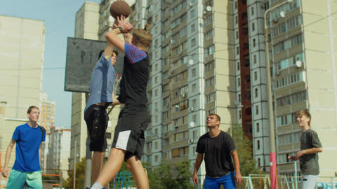 Streetball player blocking shot from offensive player Footage