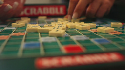 Gathering scrabble pieces Stock Video Footage